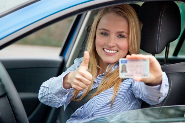Woman Showing Her Driver's License