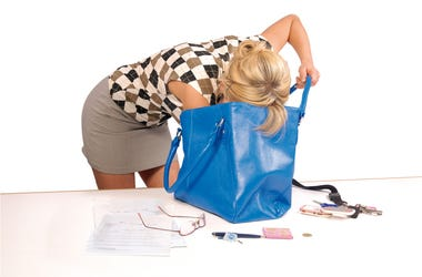 Woman Digging in Purse