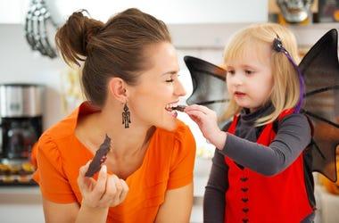 Kid Feeding Mom Candy