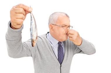 Boss Holding Fish