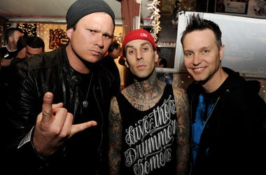 Musicians Tom DeLonge, Travis Barker and Mark Hoppus of blink-182 pose at a press party of announce the 2011 Honda Civic Tour featuring blink-182