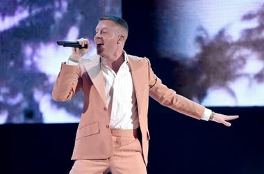 LOS ANGELES, CA - NOVEMBER 19: Macklemore performs at the 2017 American Music Awards at Microsoft Theater on November 19, 2017 in Los Angeles, California.