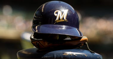 Apr 21, 2019; Milwaukee, WI, USA; A Milwaukee Brewers helmet sits on a stool prior to the game against the Los Angeles Dodgers at Miller Park. Mandatory Credit: Jeff Hanisch-USA TODAY Sports