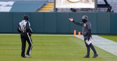 Nov 1, 2020; Green Bay, Wisconsin, USA; Green Bay Packers head coach Matt LaFleur argues a call with side judge Jabir Walker (26) during the fourth quarter against the Minnesota Vikings at Lambeau Field. Mandatory Credit: Jeff Hanisch-USA TODAY Sports