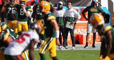 Oct 18, 2020; Tampa, Florida, USA; Green Bay Packers head coach Matt LaFleur watches from the sideline against the Tampa Bay Buccaneers during the first quarter of a NFL game at Raymond James Stadium. Mandatory Credit: Kim Klement-USA TODAY Sports
