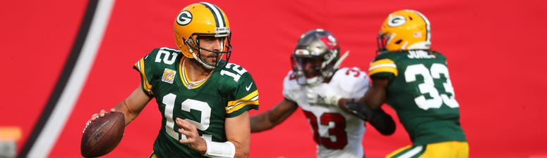 Oct 18, 2020; Tampa, Florida, USA; Green Bay Packers quarterback Aaron Rodgers (12) drops back to pass Tampa Bay Buccaneers during the second quarter of a NFL game at Raymond James Stadium. Mandatory Credit: Kim Klement-USA TODAY Sports