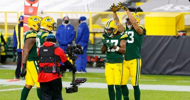 Nov 29, 2020; Green Bay, Wisconsin, USA; Green Bay Packers wide receiver Davante Adams (17) celebrates for the TV camera after catching a touchdown pass during the first quarter against the Chicago Bears at Lambeau Field. Mandatory Credit: Jeff Hanisch-US