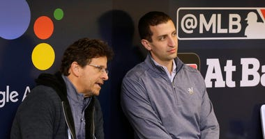 Brewers' GM David Stearns and owner Mark Attanasio chat in the dugout
