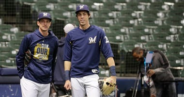 Craig Counsell and Christian Yelich