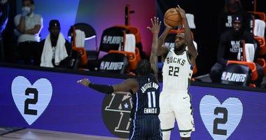 Bucks forward Khris Middleton rises up for a jumper against Orlando