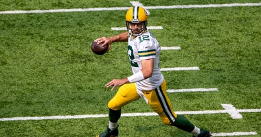 Aaron Rodgers rolls out