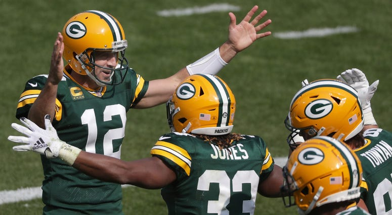 Rodgers and Jones celebrate in Packers win over Detroit