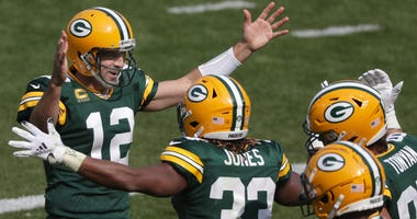 Green Bay Packers quarterback Aaron Rodgers running back Aaron Jones celebrate following an early third quarter touchdown against the Detroit Lions on Sunday, September 20, 2020, at Lambeau Field in Green Bay, Wis. Nfl Detroit Lions At Green Bay Packers