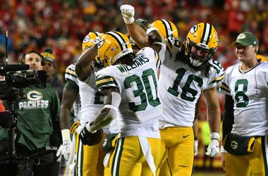 Oct 27, 2019; Kansas City, MO, USA; Green Bay Packers running back Jamaal Williams (30) celebrates with wide receiver Jake Kumerow (16) after scoring during the second half against the Kansas City Chiefs at Arrowhead Stadium. Mandatory Credit: Denny Medle