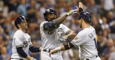 Eric Thames high fives his teammates