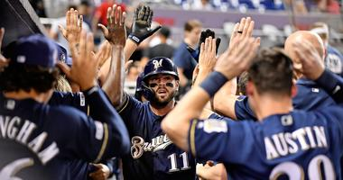Mike Moustakas high fives his teammates