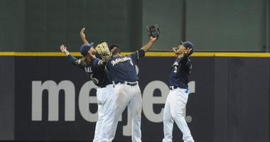 Brewers celebrate a win against the Pirates