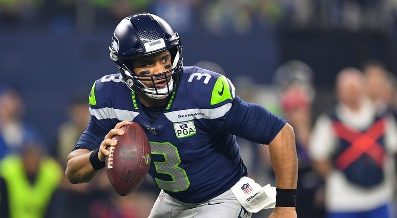 Russell Wilson Seattle Seahawks Dallas Cowboys NFL Wild Card
