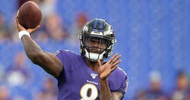 Baltimore Ravens quarterback Lamar Jackson (8) throws before the game against the Jacksonville Jaguars at M&T Bank Stadium