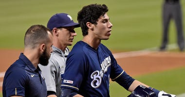 Milwaukee Brewers right fielder Christian Yelich (22) leaves the game after suffering an apparent injury in the first inning against the Miami Marlins at Marlins Park