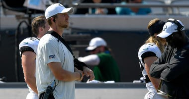 acksonville Jaguars quarterback Nick Foles (7) looks on from the sidelines in a sling during the fourth quarter against the Kansas City Chiefs
