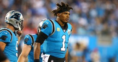 Carolina Panthers quarterback Cam Newton (1) walks off the field during the second quarter against the Tampa Bay Buccaneers at Bank of America Stadium.