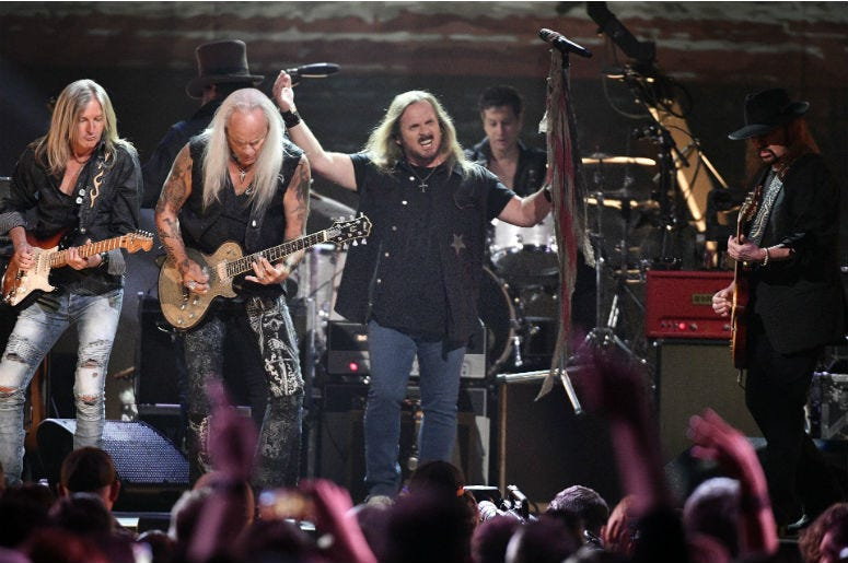 Members of Lynyrd Skynyrd perform during the Merle Haggard Tribute concert at Bridgestone Arena.