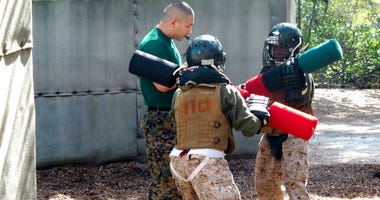 Female recruits battle with pugil sticks during training at the Marine Corps Training Depot