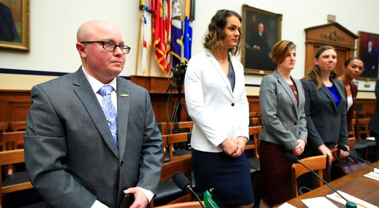 Transgender military members  listen before the start of a House Armed Services Subcommittee on Military Personnel