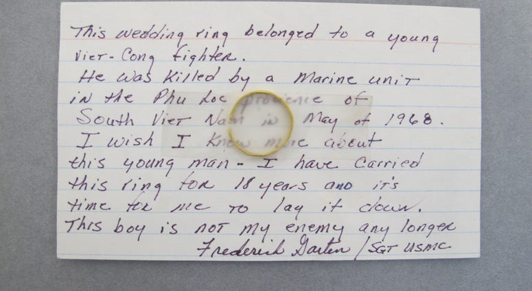 Visitors to the Vietnam Veterans Memorial sometimes leave items or remembrancesThis note with the attached wedding ring of a Vietnamese soldier is among the examples that will be on display at the New-York Historical Society