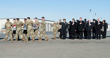 A U.S. Army carry team transfers the remains of Spc. Collette