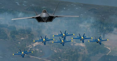 F-22 Raptor makes historic flight with Blue Angels