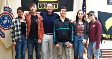 The five Wierzbicki siblings, Haley, Mason, Austin, Sequia and Sierra, take a photo with Staff Sgt. Lucas Jansson