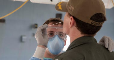 Navy Seaman Hayden Runyon, a medical corpsman assigned to 3rd Medical Battalion, 3rd Marine Logistics Group