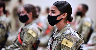 Advanced individual training soldiers wearing face masks listen to Maj. Gen. Dennis LeMaster