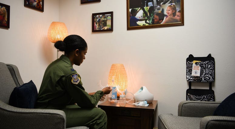 Capt. Ebony Godfrey, 20th Air Force nuclear command, control and communication operations chief, assembles a breast pump