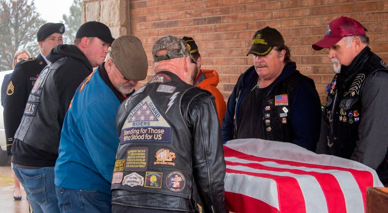 Veterans with coffin