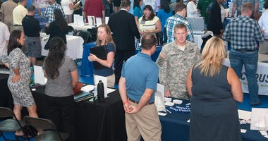 Service members, veterans and military dependents attend a hiring fair as part of the Hawaii Transition Summit July 9, 2015 at Joint Base Pearl Harbor-Hickam, Hawaii.
