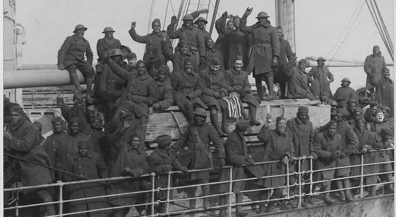 """War Department. New York's 369th Infantry (formerly the 15th Infantry) of African American troops arrive back home at Hoboken, New Jersey. According to the original caption, """"they are the only regiment which never had one of their men captured and never l"""