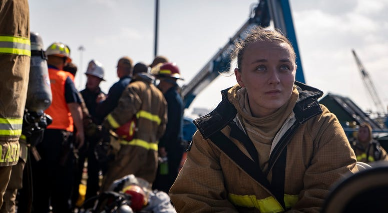 Navy firefighter rests