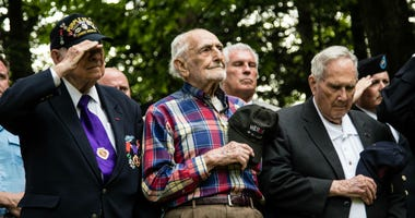 WWII veterans pay respect to the U.S. flag at the 30th ID Old Hickory memorial ceremony on June 2 at Mortain, France.