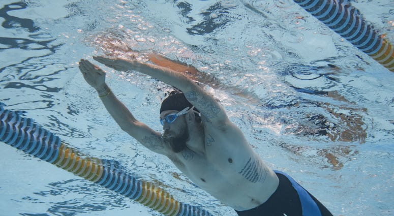 Retired Technical Sgt. William Royster fine tunes his swimming techniques in preparation for the 2019 DoD Warrior Games