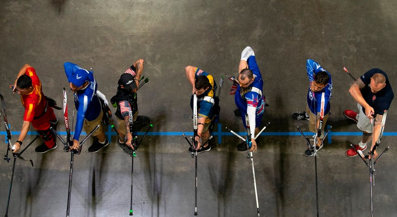 Archers begin the final rounds of archery in the recurve bow division