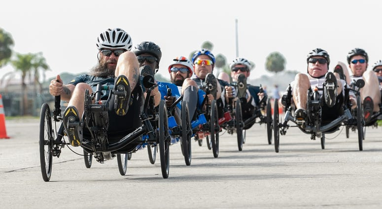 U.S. Navy veteran Chief Petty Officer Joshua Erickson, Team Navy, leads competitors during the 2019 DoD Warrior Games cycling road race