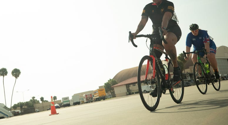 U.S. Army Spc. Stephanie Johnson competes in the cycling road race event