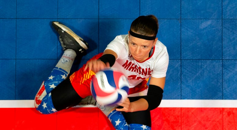 Marine Cpl. Tisha Knickerbocker serves during a preliminary volleyball match