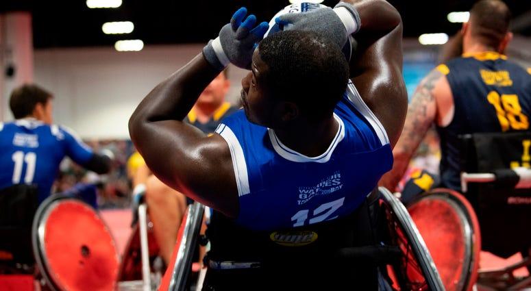 Air Force Senior Airman Demarcus Garrett leans back into a goal during the wheelchair rugby gold medal match