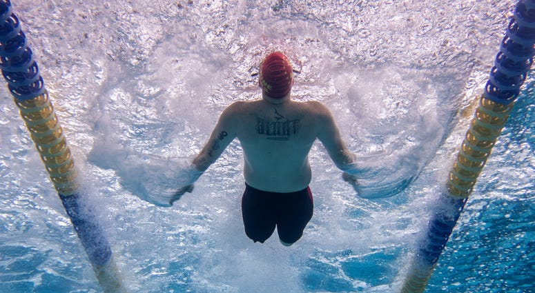 Marine Corps Veteran Pfc. Isaac Blunt competes in the 50 meter backstroke using his own unique swim technique
