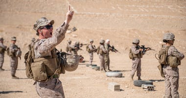 JORDAN (Aug. 1, 2019) Cpl. Riley Guidi, assigned to the 11th Marine Expeditionary Unit (MEU) Female Engagement Team, gives the course of fire to Marines and members of the Jordan Armed Forces Quick Reaction Force Female Engagement Team during a live-fire