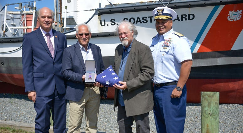 U.S. Representative Bill Keating, Bradley Finch, Stephen Finch, and Adm. Andy Tiongson pose for a photo